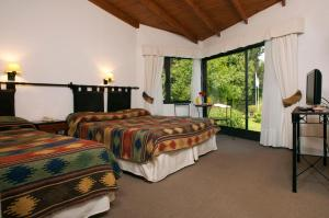 A bed or beds in a room at Sierra Nevada