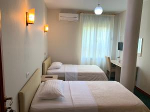 A bed or beds in a room at Kriva Resort