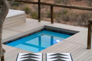 The swimming pool at or near Royal Madikwe Luxury Safari Lodge
