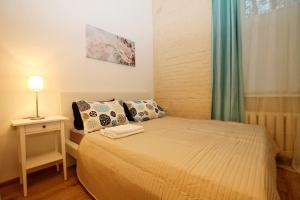 A bed or beds in a room at capital apartments
