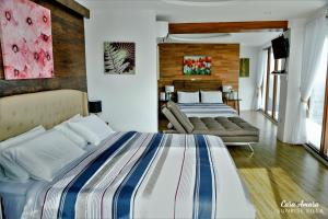 A bed or beds in a room at Casa Amara