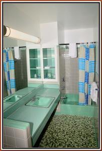 A bathroom at The Cardinal Inn