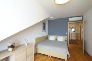 A bed or beds in a room at Vinohrady Moravska Apartments