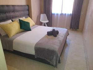 A bed or beds in a room at Charming Marrakech Apartement