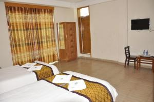 A bed or beds in a room at Mekelle Hotel