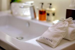 Un baño de Singer Palace Hotel