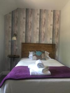 A bed or beds in a room at Mullions 51 B&B