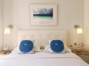 A bed or beds in a room at Alexandris Hotel
