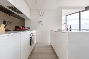 A kitchen or kitchenette at Unbridled City & River Views