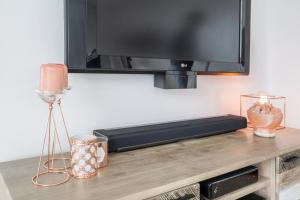 A television and/or entertainment center at Unbridled City & River Views