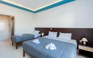 A bed or beds in a room at Callinica Hotel