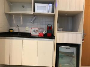 A kitchen or kitchenette at Boulevard Residencial