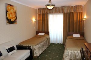 Кровать или кровати в номере Отель Домик у Причала