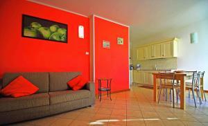 Coin salon dans l'établissement Residence La Collina