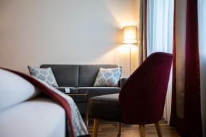 Ein Sitzbereich in der Unterkunft Hotel Elefant Family Business