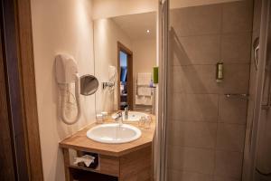 Ein Badezimmer in der Unterkunft Hotel Elefant Family Business