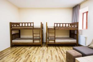 A bunk bed or bunk beds in a room at ngrg