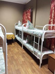 A bunk bed or bunk beds in a room at HotelHot Firsanovka