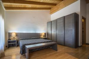 Postel nebo postele na pokoji v ubytování La Pergola Hotel