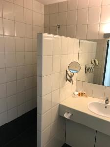 Een badkamer bij Hampshire Hotel - Avenarius