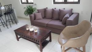 Uma área de estar em Tropisch centraal gelegen appartement 5 min van MamboBeach in 1 van de mooiste villaparken van Curacao