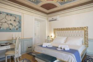 Letto o letti in una camera di Les Suite Royales