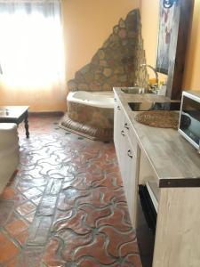 Una cocina o zona de cocina en La Hacienda del Marquesado