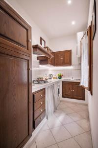 Una cocina o zona de cocina en Novella Benedicta Apartments
