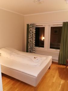 En eller flere senger på et rom på Farm Inn
