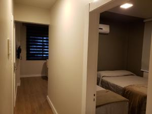 A bed or beds in a room at Apartamento Vila Real