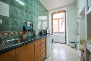 A kitchen or kitchenette at DuplexduBocage
