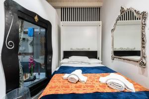 Cama o camas de una habitación en Tanasa & Profugando Relax