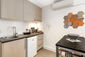 A kitchen or kitchenette at BRAND NEW COZY STUDIO IN BEST SPOT - Bondi Beach