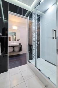 A bathroom at Lux Apartment Center
