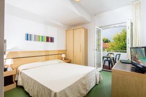Postel nebo postele na pokoji v ubytování La Pergola Dependance
