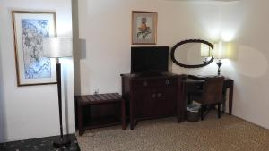 A television and/or entertainment centre at Crown Vista Hotel