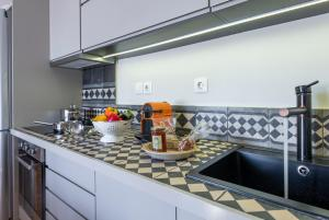 A kitchen or kitchenette at Hidesign Athens Luxury Apartments in Kolonaki