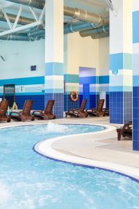 The swimming pool at or close to AMAKS Krasnaya Pakhra Resort