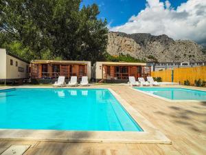 The swimming pool at or near Mediteran Travel Mobile Homes Galeb