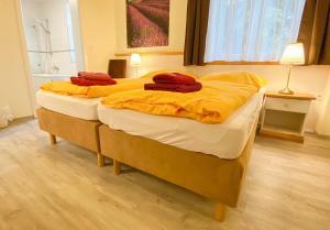 Ein Bett oder Betten in einem Zimmer der Unterkunft Gästehaus Alte Bäckerei