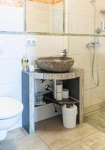 Ein Badezimmer in der Unterkunft Hotel Restaurant Mühlenhof Bosse