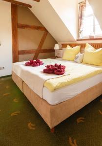 Ein Bett oder Betten in einem Zimmer der Unterkunft Hotel Restaurant Mühlenhof Bosse