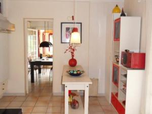 A kitchen or kitchenette at Comfortable Holiday Home with Private Pool in Pierrerue