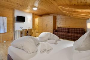 Ein Bett oder Betten in einem Zimmer der Unterkunft Walchauhof