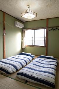 みんなの秘密基地 TSUKASAハウスにあるベッド