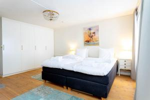 Säng eller sängar i ett rum på ApartDirect Gamla Stan II