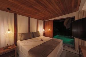 Cama ou camas em um quarto em Pousada Reserva do Patacho