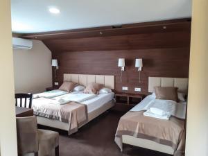Ein Bett oder Betten in einem Zimmer der Unterkunft Stadthotel Reutlingen
