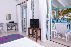A television and/or entertainment center at Inchcape Seaside Villas