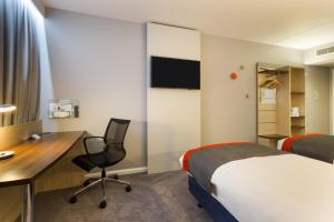 A television and/or entertainment center at Holiday Inn Express London - Watford Junction